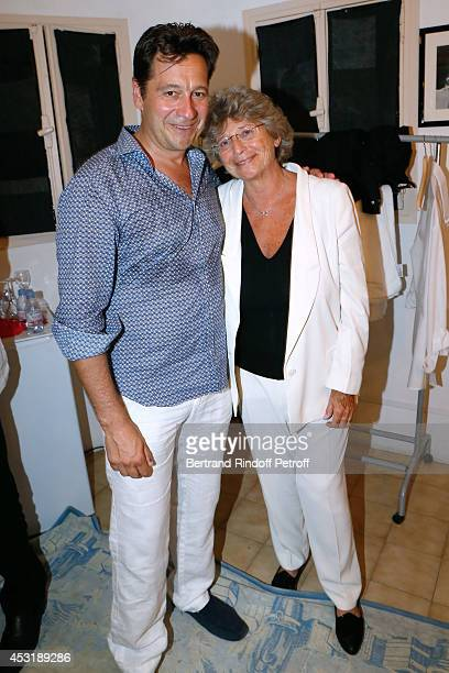 French impersonator Laurent Gerra poses backstage with President of Ramatuelle Festival Jacqueline Franjou after his show at the 30th Ramatuelle...