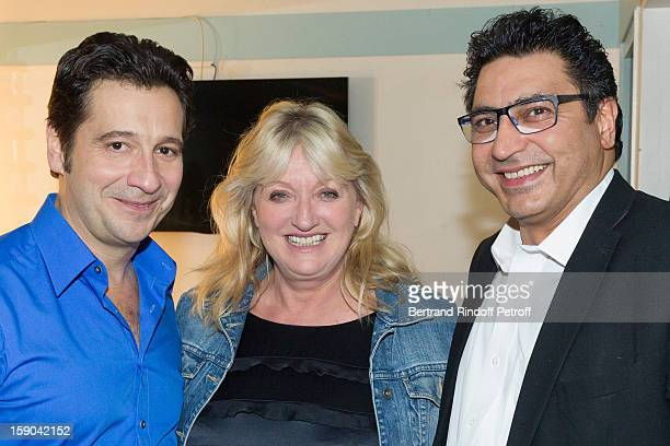 French impersonator Laurent Gerra poses in his dressing room with Charlotte de Turckheim and her husband Zaman Hachemi following his man show at...