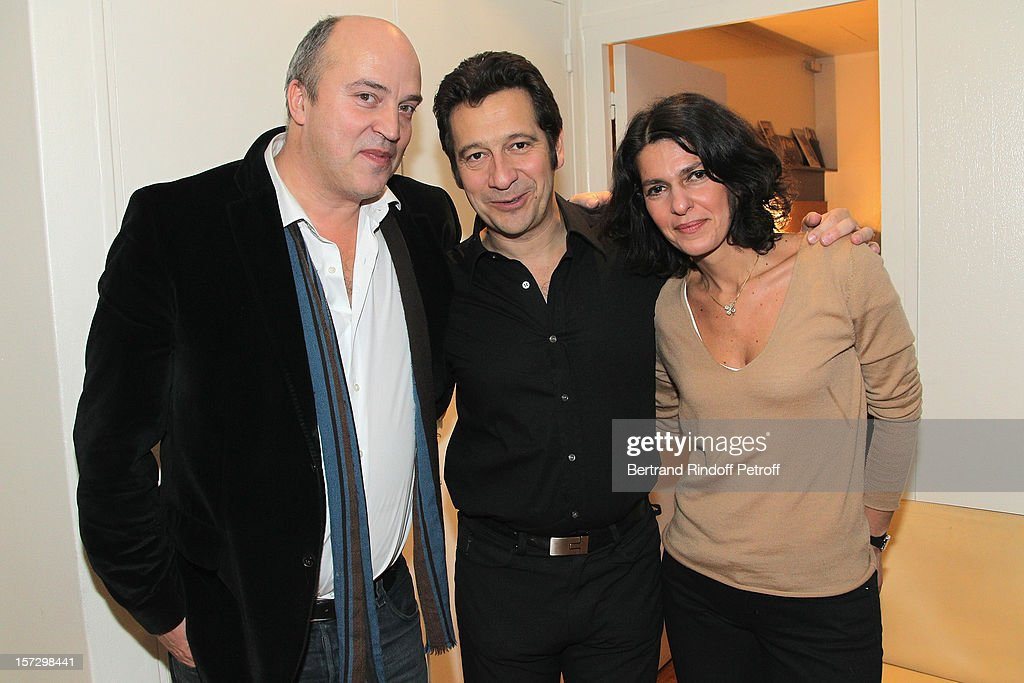 French impersonator Laurent Gerra (C) poses with journalist Vincent Parizot (L) and Parisot's wife Golriz, in Gerra's dressing room, following his One Man Show at Palais des Congres on November 30, 2012 in Paris, France.