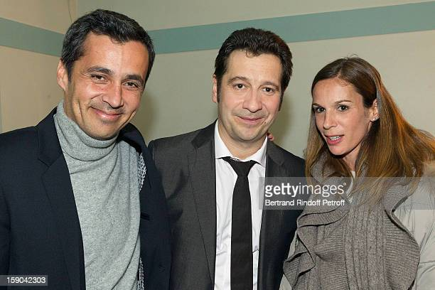 French impersonator Laurent Gerra (C) poses with Olivier Galzi (L) and guest in his dressing room following his one man show at Olympia hall on January 5, 2013 in Paris, France.