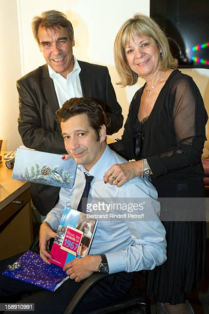French impersonator Laurent Gerra who turned 45 on December 29 holds some of his birthday presents as he poses with his mother Nicole and father...