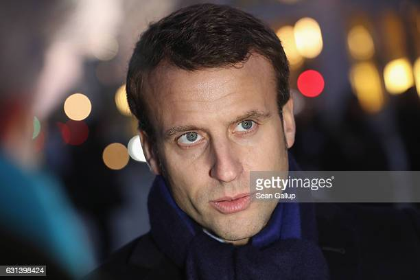 French independent presidential candidate Emmanuel Macron speaks to the media after he laid flowers at a memorial to the December 19 terror attack at...