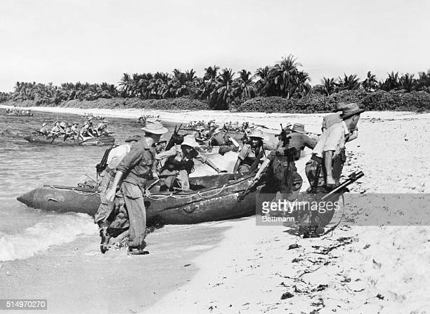French Indochina: Striking Back. Commandos of the French Union forces jump from rafts after crossing the Black River in French Indochina. They hacked...