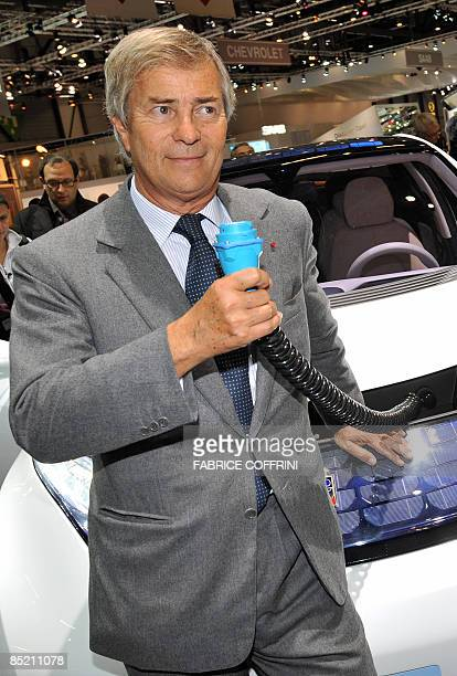 French industrialist and businessman Vincent Bollore poses in front of the BollorePininfarina BlueCar a small electric city car during the launch of...