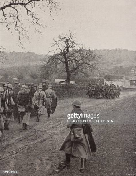 A French infantry column intersecting a group of German prisoners Spring Offensive France World War I from l'Illustrazione Italiana Year XLV No 16...