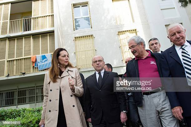 French Interior Minister Bernard Cazeneuve and French rightwing opposition UMP party member of parliament and mayor of Marseille's sixth sector...