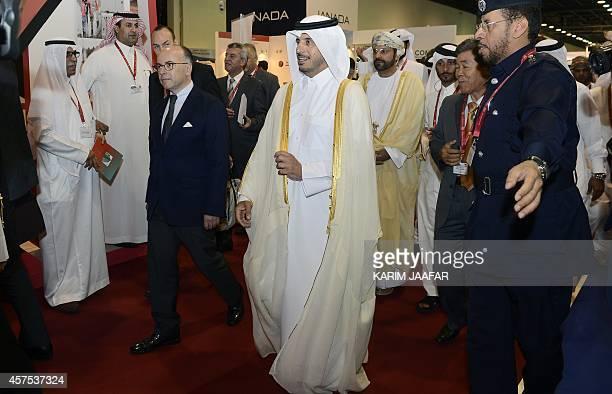 French Interior Minister Bernard Cazeneuve and Qatari Prime Minister Sheikh Abdullah bin Nasser bin Khalifa alThani attend the opening of the Milipol...