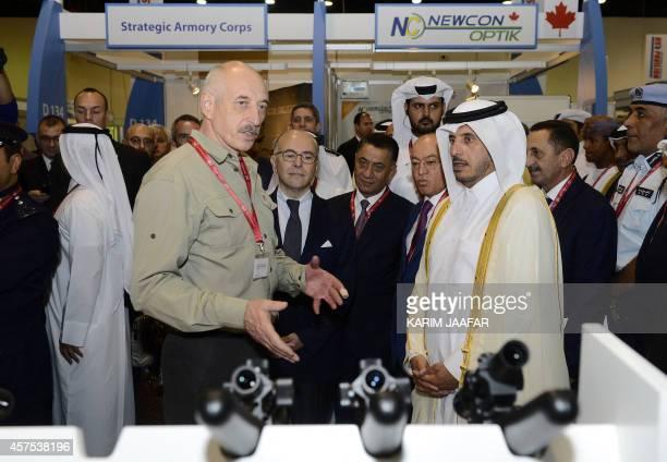 French Interior Minister Bernard Cazeneuve and Qatari Prime Minister Sheikh Abdullah bin Nasser bin Khalifa alThani listen to explanations as they...