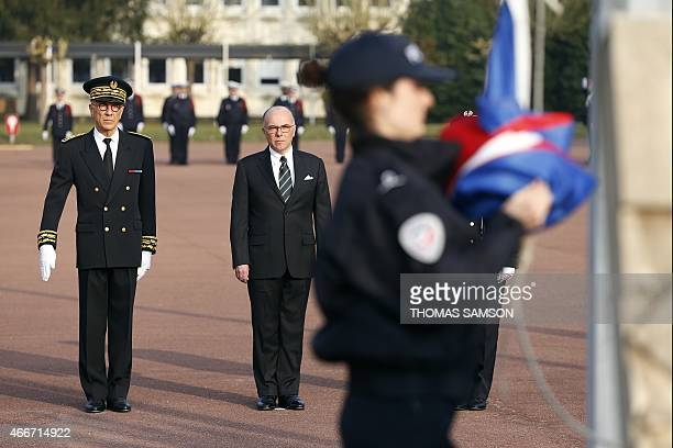 French Interior Minister Bernard Cazeneuve and SeineetMarne Prefect JeanLuc Marx Helene Martini attend a graduation ceremony at the Ecole Nationale...