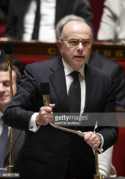 French Interior minister Bernard Cazeneuve delivers a speech during a session of Questions to the Government on January 20 2015 at the French...