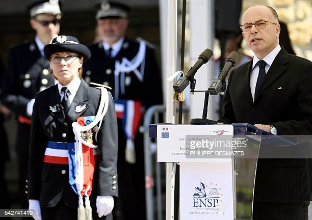 French interior minister Bernard Cazeneuve delivers a speech next to school director Helene Martini during a ceremony of the 20th promotion of the...