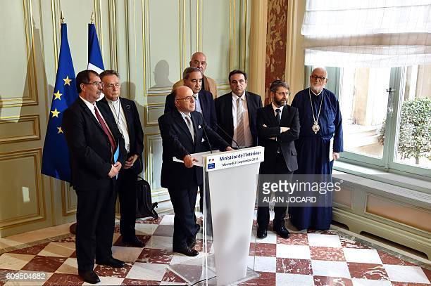 French Interior minister Bernard Cazeneuve flanked by President of the French Council of the Muslim Faith Anouar Kbibech President of Bishops of...