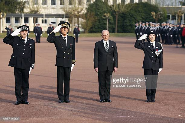 French Interior Minister Bernard Cazeneuve Helene Martini director of the Ecole Nationale Superieure des Officiers de Police and SeineetMarne Prefect...