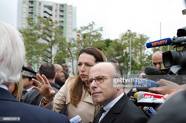 French Interior Minister Bernard Cazeneuve listens to French rightwing opposition UMP party member of parliament and mayor of Marseille's sixth...