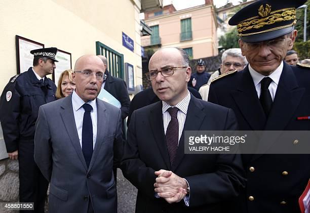 French Interior Minister Bernard Cazeneuve speaks to Eric Ciotti French National Assembly member representing the AlpesMaritimes department...