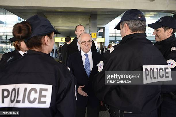 French Interior Minister Bernard Cazeneuve speaks to police officers as he visits members of the police and military services ensuring security at...