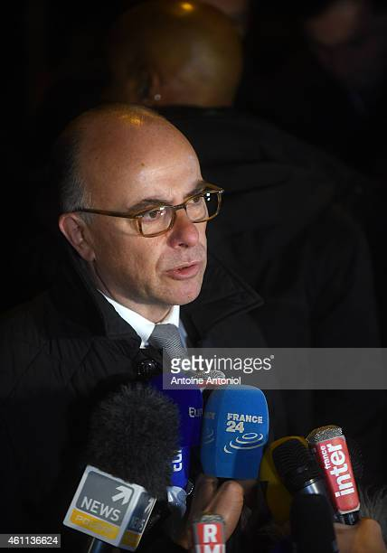 French Interior Minister Bernard Cazeneuve speaks to the press at the offices of the French satirical newspaper Charlie Hebdo on January 7 2015 in...