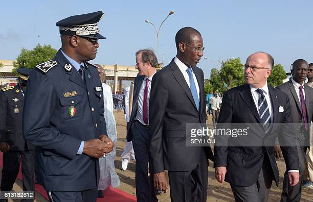 French Interior Minister Bernard Cazeneuve talks with his Senegalese counterpart Abdoulaye Daouda Diallo and Oumar Maal general director of the...