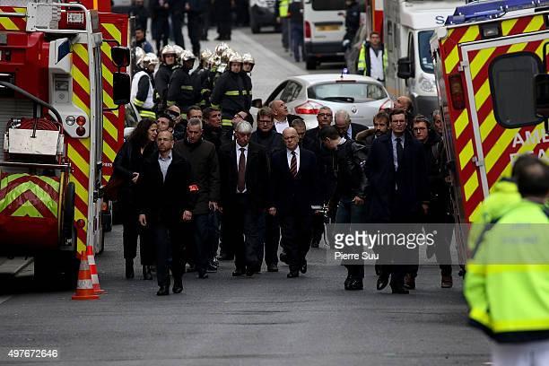 French Interior Minister Bernard Cazeneuve visits the site of this morning's police raid at the 'Rue de la Republique' close to where the police raid...