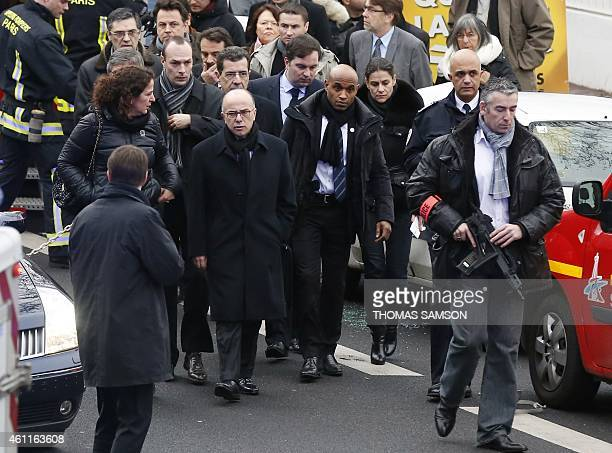 French Interior Minister Bernard Cazeneuve walks at the site of a shooting on the morning of January 8, 2015 in Montrouge, south of Paris. A...