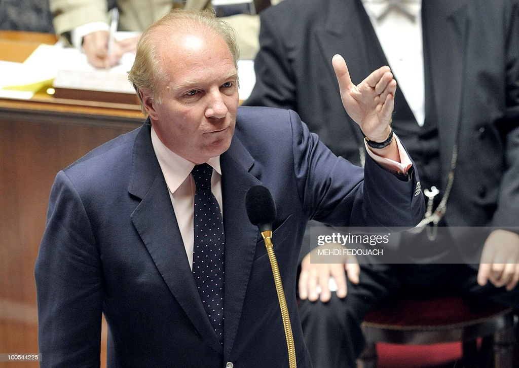 French Interior minister Brice Hortefeux answers a question asked by Socialist deputy Laurent Fabius (not in pic.) during the session of questions to the government on May 25, 2010 at the National Assembly in Paris.