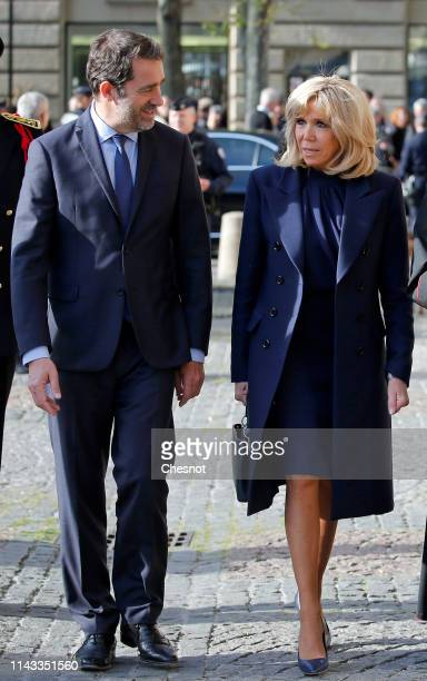 French Interior Minister Christophe Castaner and wife of French President Brigitte Macron arrive to attend the annual Chrism Mass at SaintSulpice...