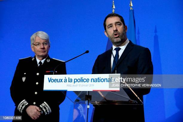French Interior Minister Christophe Castaner flanked by French police's head Eric Morvan delivers a speech during the ceremony for the new year...