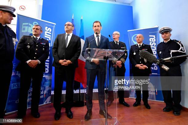 French Interior Minister Christophe Castaner flanked by French Junior Interior Minister Laurent Nunez delivers a speech during a visit to the police...