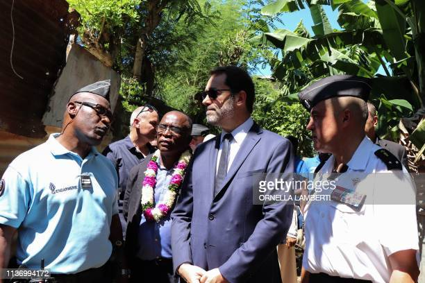 French Interior Minister Christophe Castaner flanked by police officers visits La Vigie district a shantytown in PetiteTerre at the start of his...