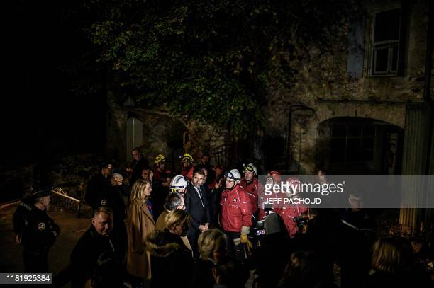 French Interior Minister Christophe Castaner meets firefighters as he visits the Rouviere quarter in Le Teil southeastern France on November 12 the...