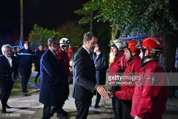 French interior minister Christophe Castaner meets firefighters in Le Teil southeastern France on November 12 the day after an earthquake with a...