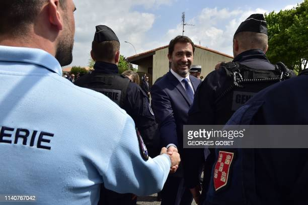 TOPSHOT French Interior Minister Christophe Castaner shakes hands with a gendarme as he visits a gendarmerie station in TerresdeHauteCharente near...