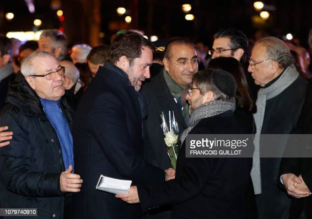 French Interior Minister Christophe Castaner shakes hands with Chief Rabbi of France Haim Korsia flanked by French Junior Minister attached to the...