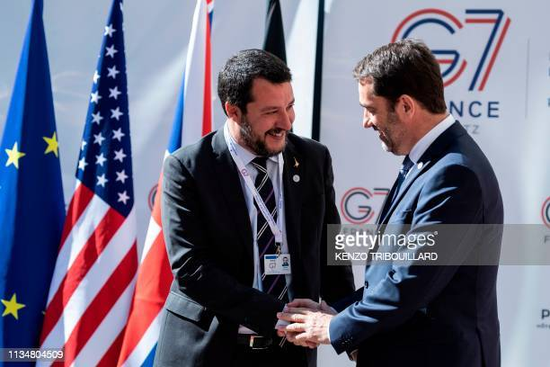 French Interior Minister Christophe Castaner shakes hands with his Italian counterpart Matteo Salvini upon his arrival at the French Interior...