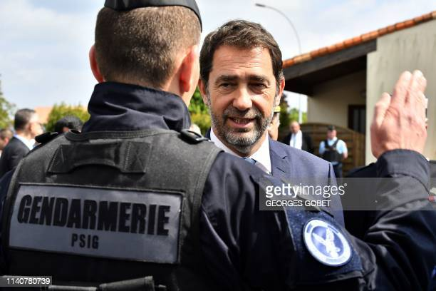 TOPSHOT French Interior Minister Christophe Castaner speaks with a Gendarme as he visits a gendarmerie station in TerresdeHauteCharente near...