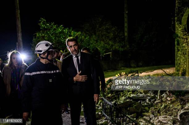 French interior minister Christophe Castaner visits the Rouviere quarter in Le Teil southeastern France on November 12 the day after an earthquake...