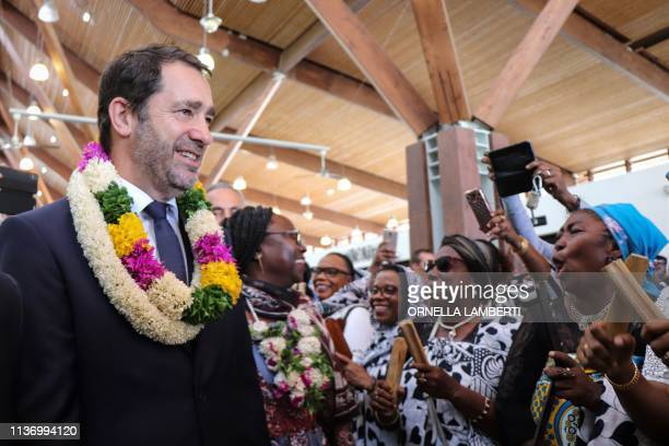 French Interior Minister Christophe Castaner wears local traditional flowers necklaces as he is welcomed with traditional songs and m'biwi dances...