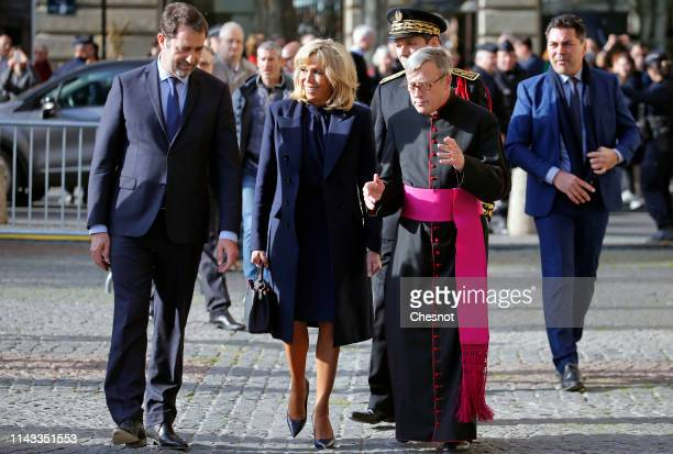 French Interior Minister Christophe Castaner wife of French President Brigitte Macron and Archbishop of Paris Michel Aupetit arrive to attend the...