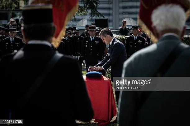 French Interior Minister Gerald Darmanin puts a medal on the coffin of late Gendarme Melanie Lemee during a ceremony at the Gendarmerie headquarters...