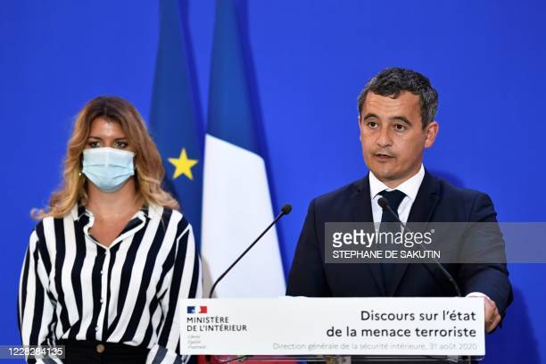 French Interior Minister Gerald Darmanin speaks, flanked by French Junior Minister of Citizenship Marlene Schiappa, during an address on the state of...