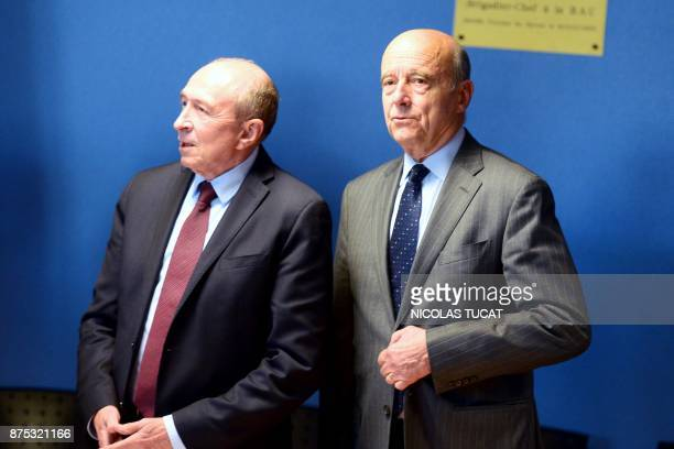 French Interior Minister Gerard Collomb and Bordeaux' mayor Alain Juppe visit the Hotel de Police in Bordeaux southwestern France on November 17 to...
