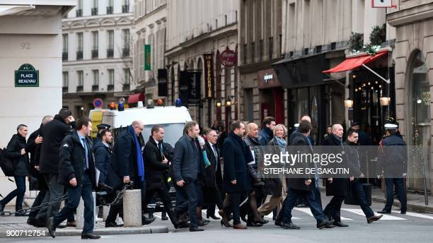 French Interior Minister Gerard Collomb and members of the French Government walk from the Interior Ministry towards the Elysee palace to attend the...
