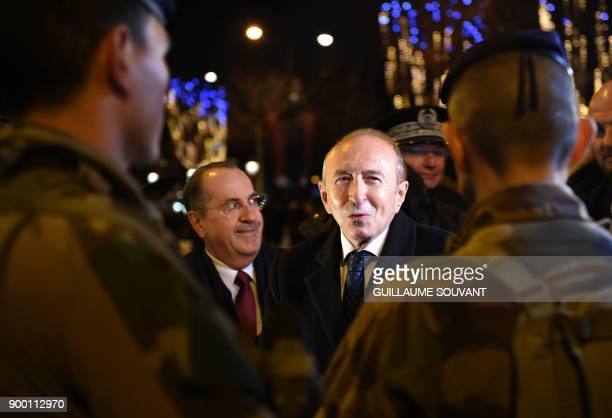 French Interior Minister Gerard Collomb and Paris' Police Prefect Michel Delpuech meet gendarmes and police officers patrolling the ChampsElysees...