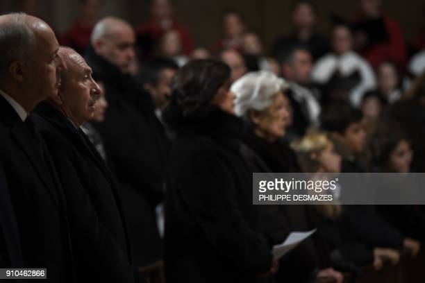 French Interior Minister Gerard Collomb attends the funeral ceremony for French chef Paul Bocuse at the SaintJean Cathedral in Lyon on January 26...