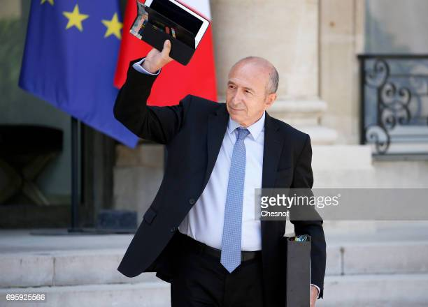 French Interior minister Gerard Collomb gestures as he leaves the Elysee Presidential Palace after a weekly cabinet meeting on June 14 2017 in Paris...
