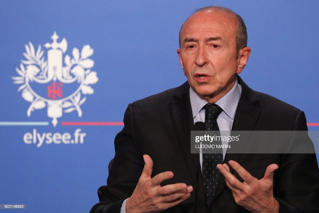 French Interior Minister Gerard Collomb gives a press conference about the new immigration law presented during the cabinet meeting earlier on February 21, 2018, in Paris. The government says the law balances 'efficiency' with 'humanity', offering faster asylum to refugees found to have fled conflict or repression. MARIN