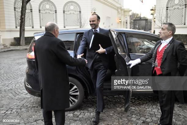 French Interior Minister Gerard Collomb greets French Prime Minister Edouard Philippe as he arrives to attend a government's New Year breakfast...