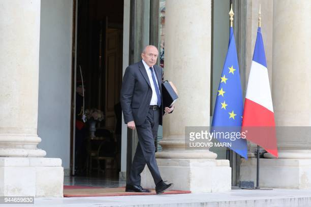 French Interior Minister Gerard Collomb leaves the Elysee Presidential Palace after the weekly cabinet meeting on April 11 2018 in Paris / AFP PHOTO...