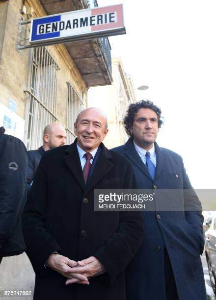 French Interior Minister Gerard Collomb leaves the gendarmerie of Libourne with Libourne Mayor Philippe Buisson on November 17 after a meeting to...