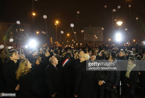 French Interior Minister Gerard Collomb looks on as white balloons are released during a gathering organized by the Conseil Representatif des...